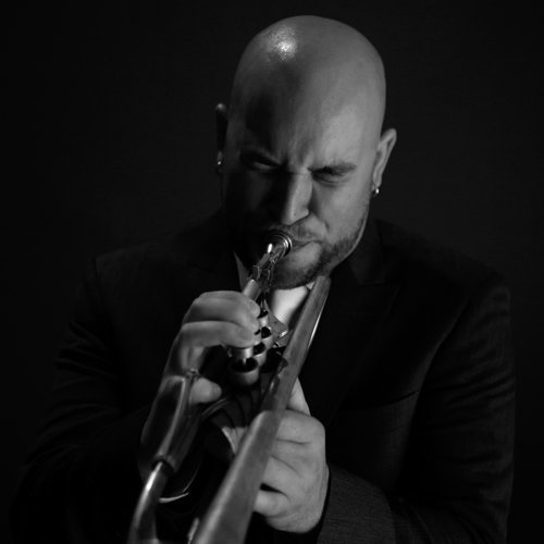 mark levron playing a trumpet