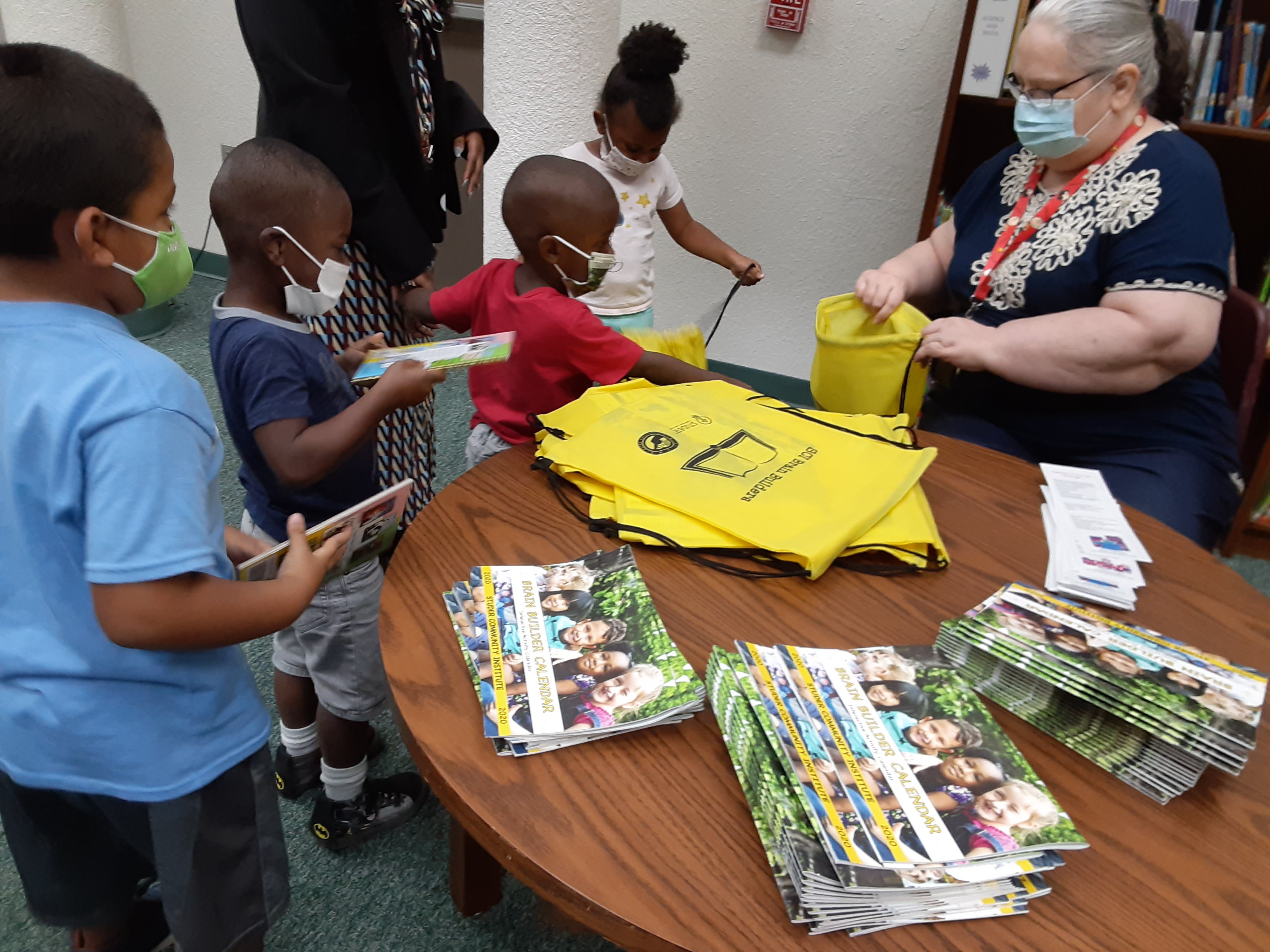 Lincoln Park students receiving book bags