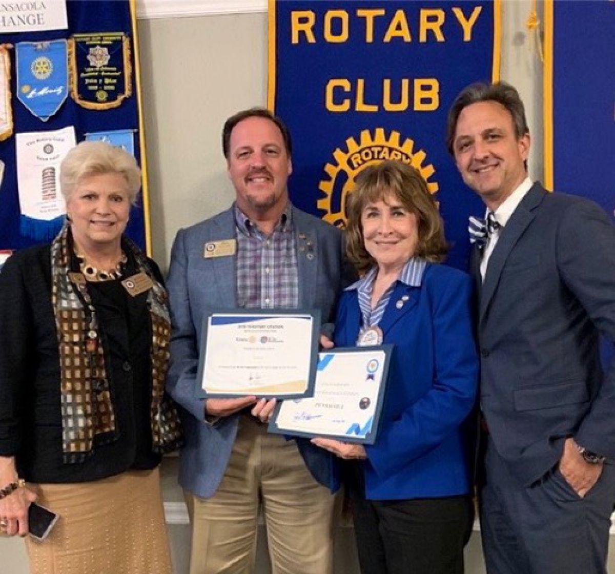 Rotary Club members receiving an award