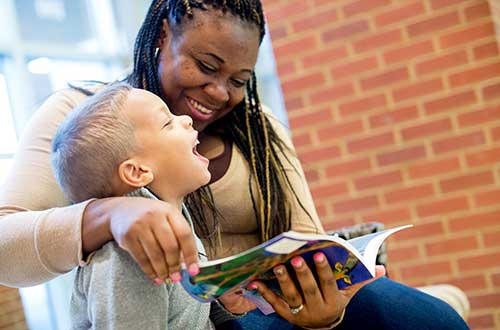 picture of a woman reading to a child