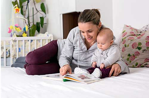 mother reading to a baby