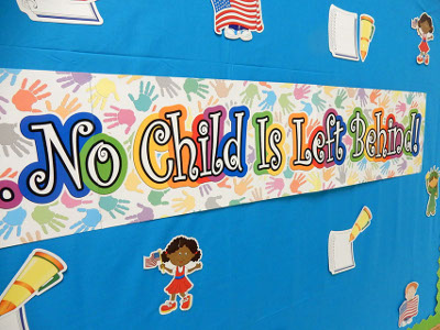 Classroom bulletin board with No Child is Left Behind banner