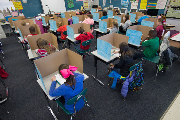 Children testing in classroom
