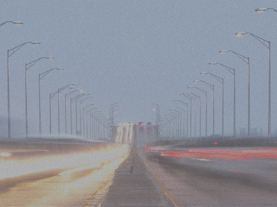 Blurred image of vehicles crossing a bridge