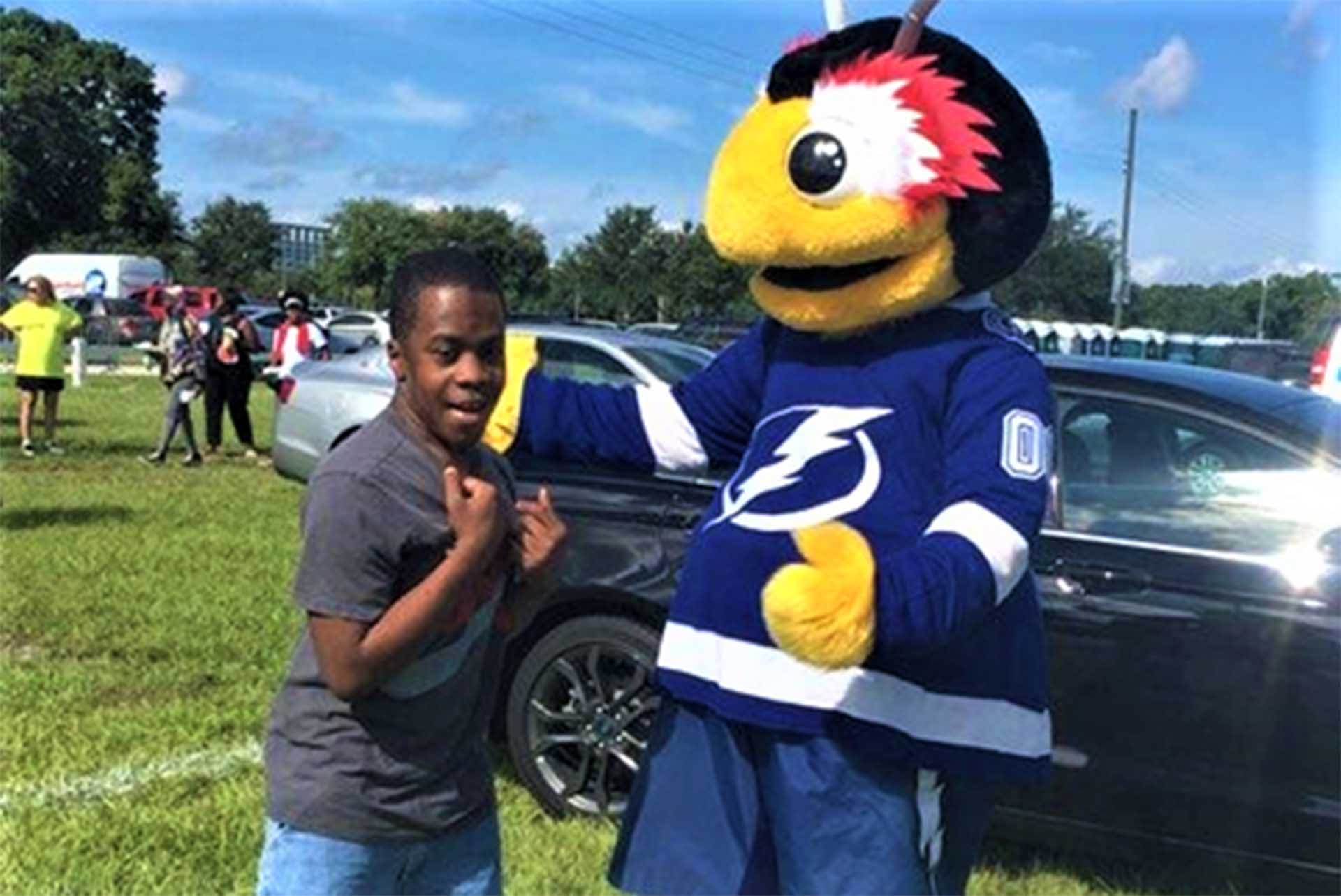 Care Member with a mascot