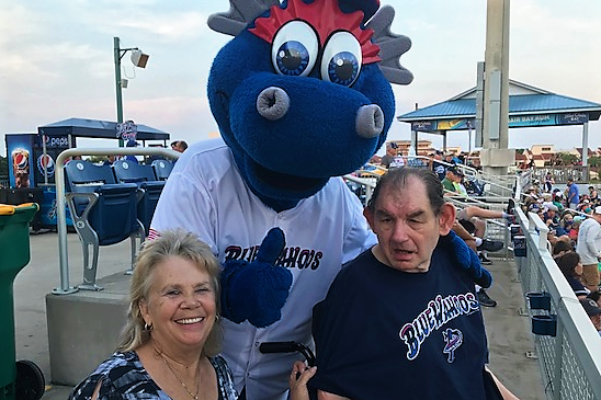 Care members with the Blue Wahoos Mascot