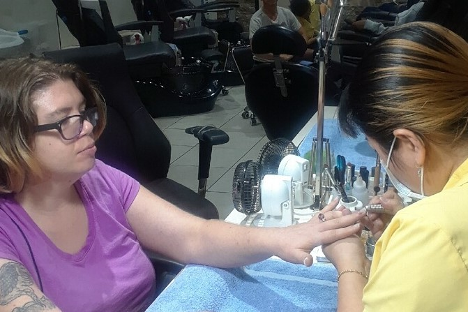 Pensacola Care Member getting nails done