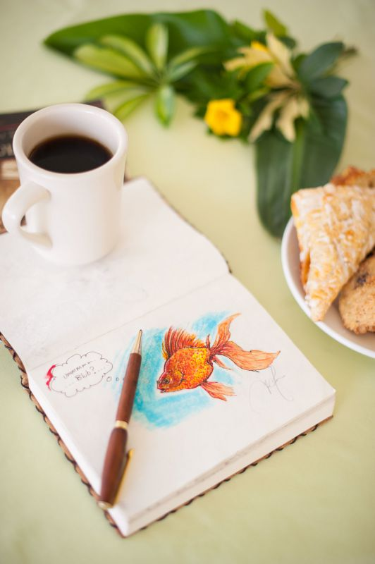 coffee mug, notebook and pastries
