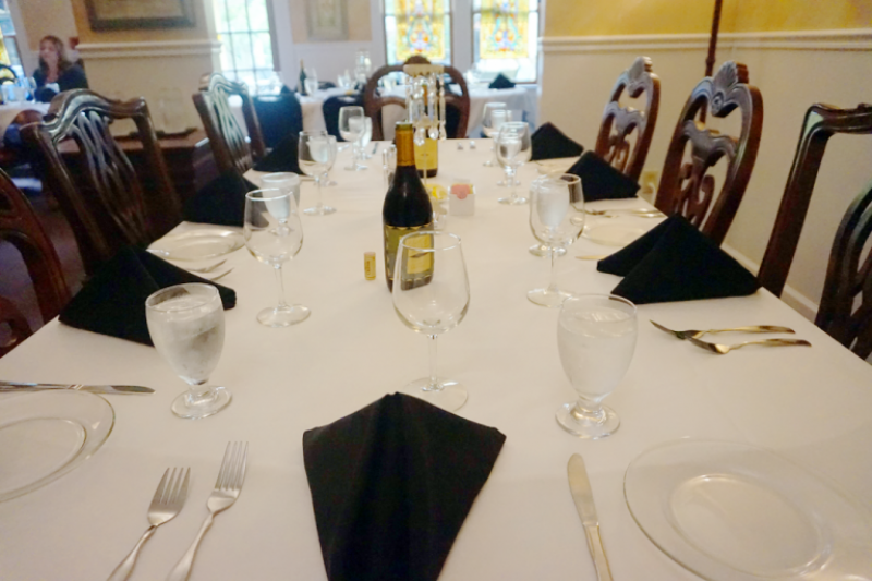 Event dining table with linens and silverware