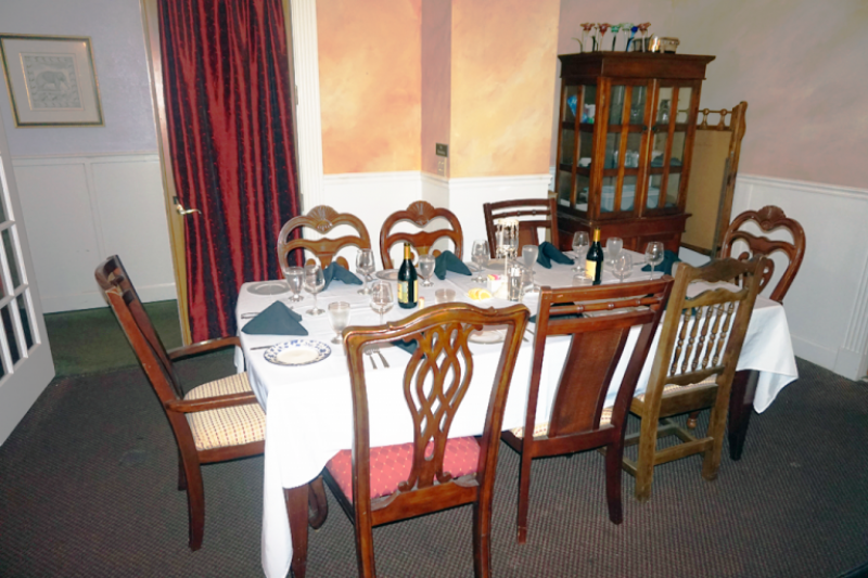 Event dining room with chairs and linens