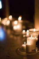 lit candles at a wedding ceremony