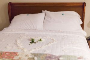 bed with a heart made of flower petals