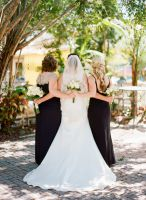 Bride with bridal party posing outside for a picture