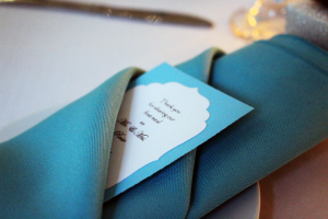 turquoise napkin with wedding announcement card