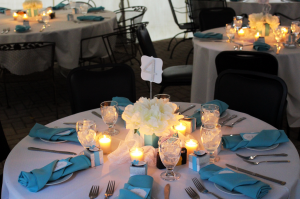 Wedding tables at a reception with napkins and candles