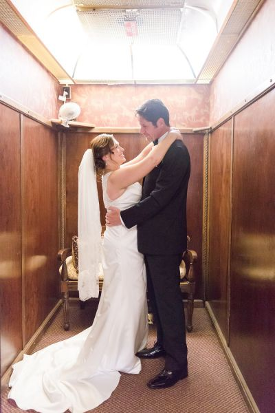 Bride and groom taking a picture  in an elevator