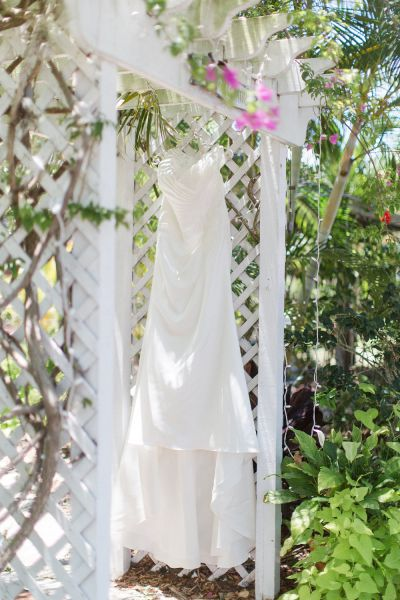 a wedding dress hanging outside