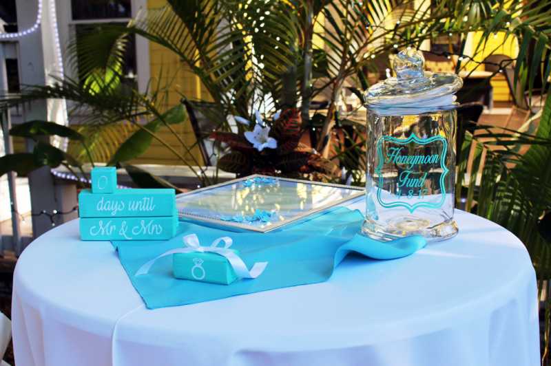 Wedding table with white table cloth and turquoise presents