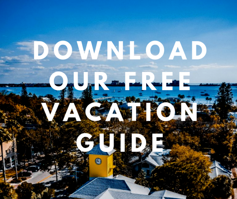 Overlooking Historic Peninsula Inn. Text written on image says Download Our Free Vacation Guide