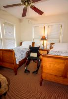 wheelchair between two twin beds