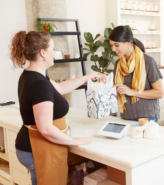 Image of Retail Store Cashier and Customer