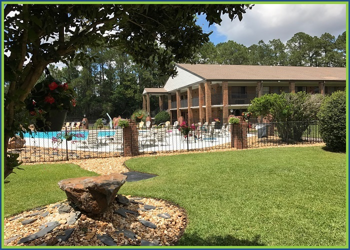 At Home Inn Pensacola Florida Side View to Pool Area