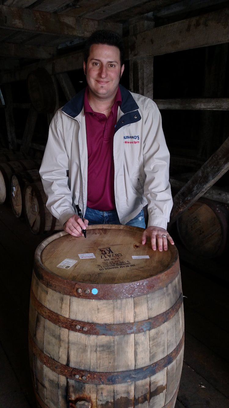 Jonathan Signing a Whiskey Barrel