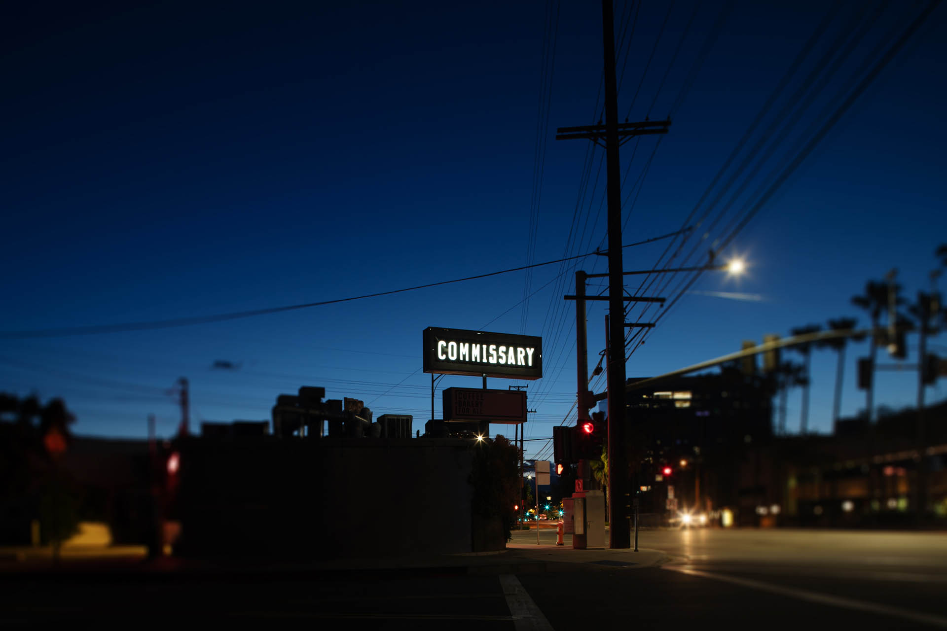 The Burbank Coffee Commissary sign lit up at night