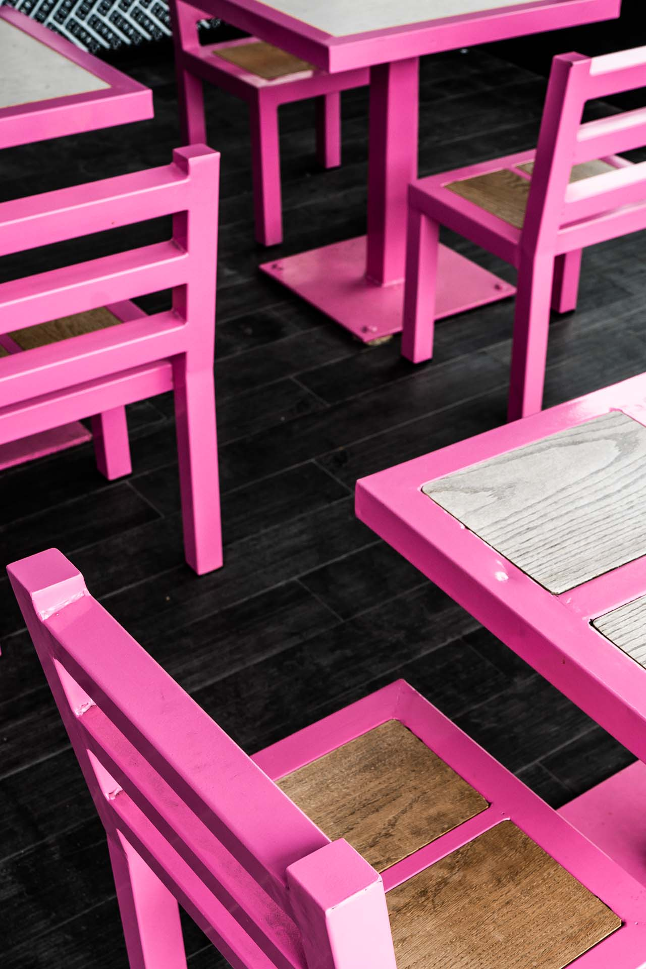 The pink tables inside the Santa Monica Coffee Commissary location