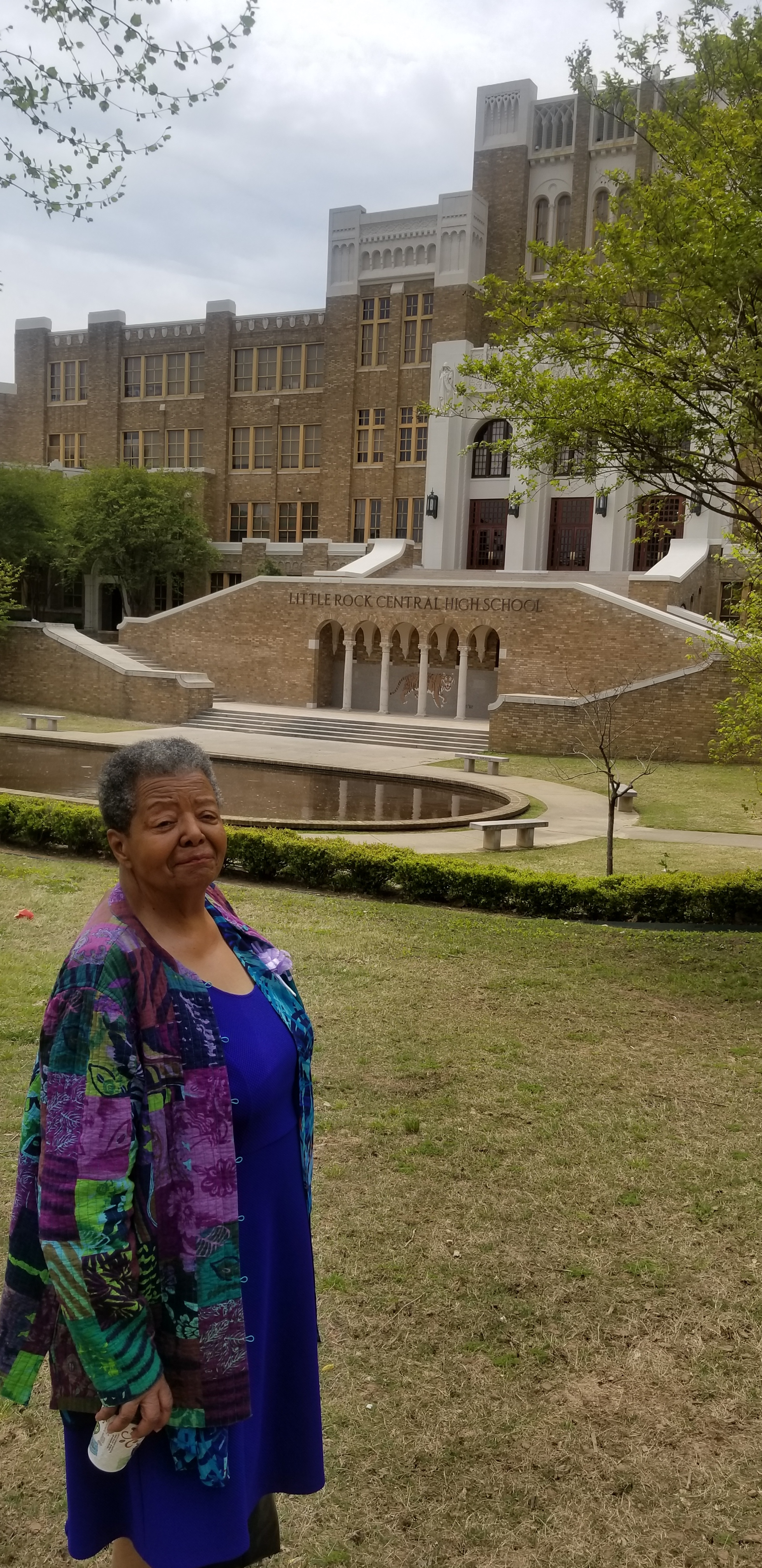 Elizabeth Eckford posing in front of little rock central high school