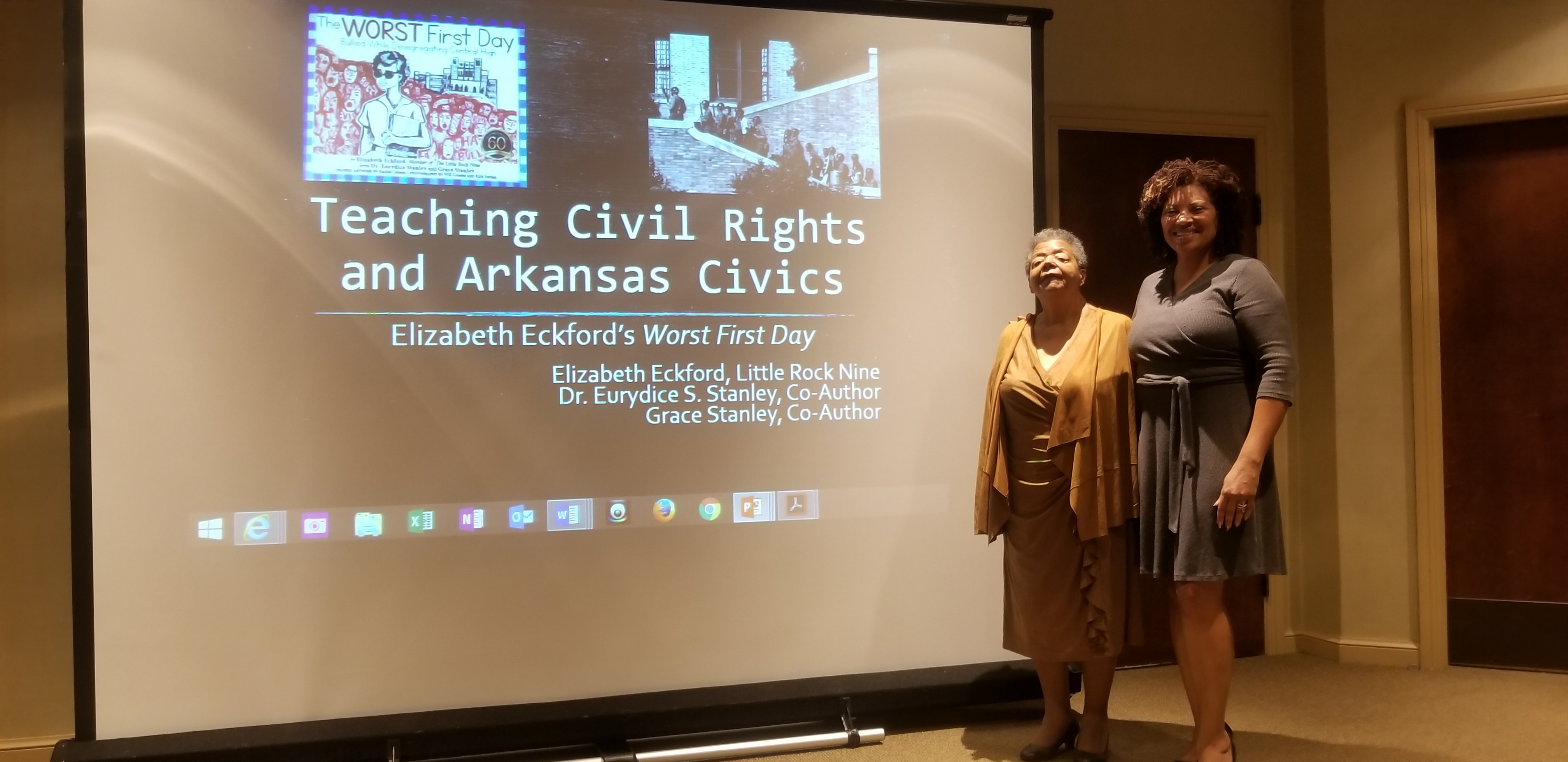Elizabeth Eckford and Eurydice Stanley standing in front of presentation screen
