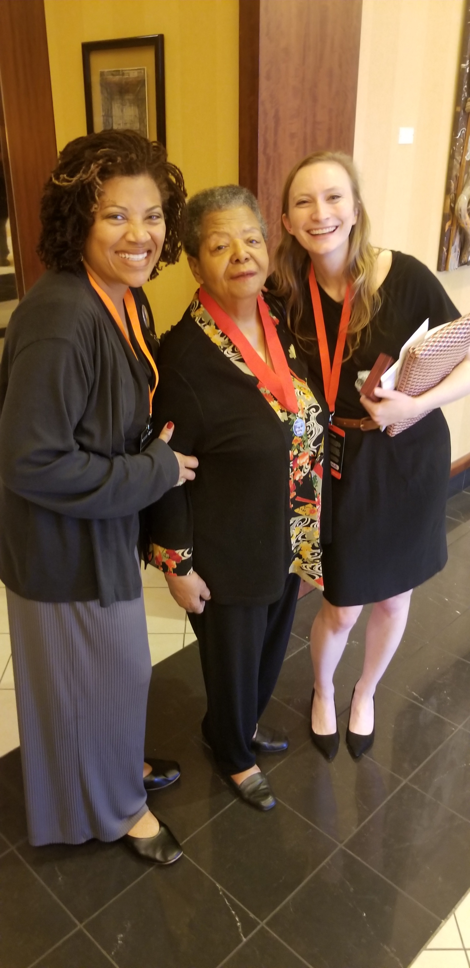 Elizabeth Eckford and Eurydice Stanley posing with fan