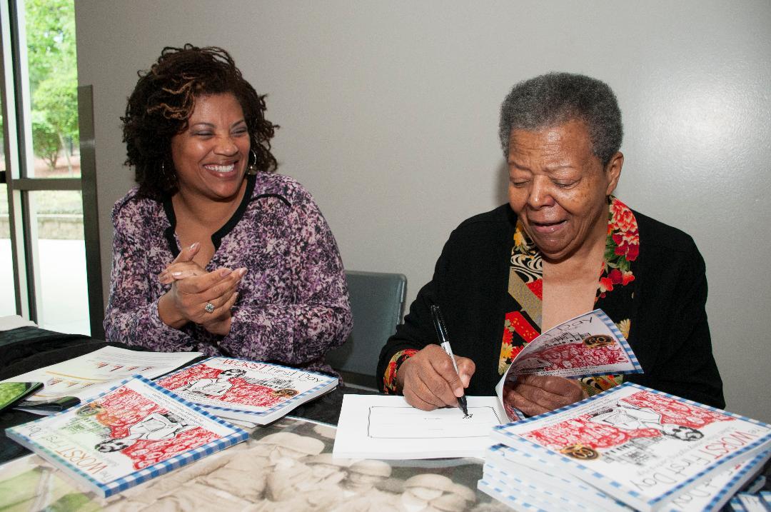 Elizabeth Eckford and Eurydice Stanley signing books