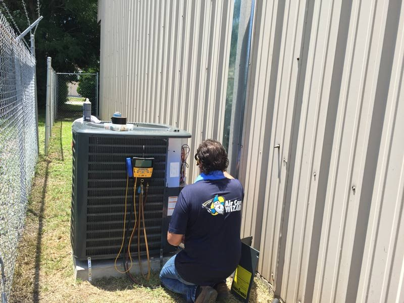 employee testing HVAC system
