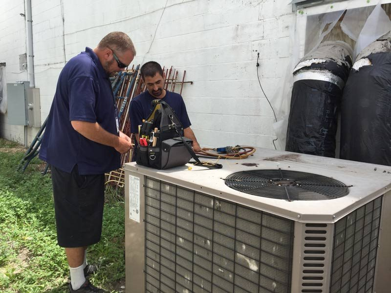 Employees working on HVAC