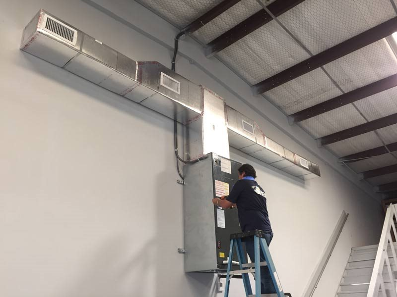 employee working on interior ductwork