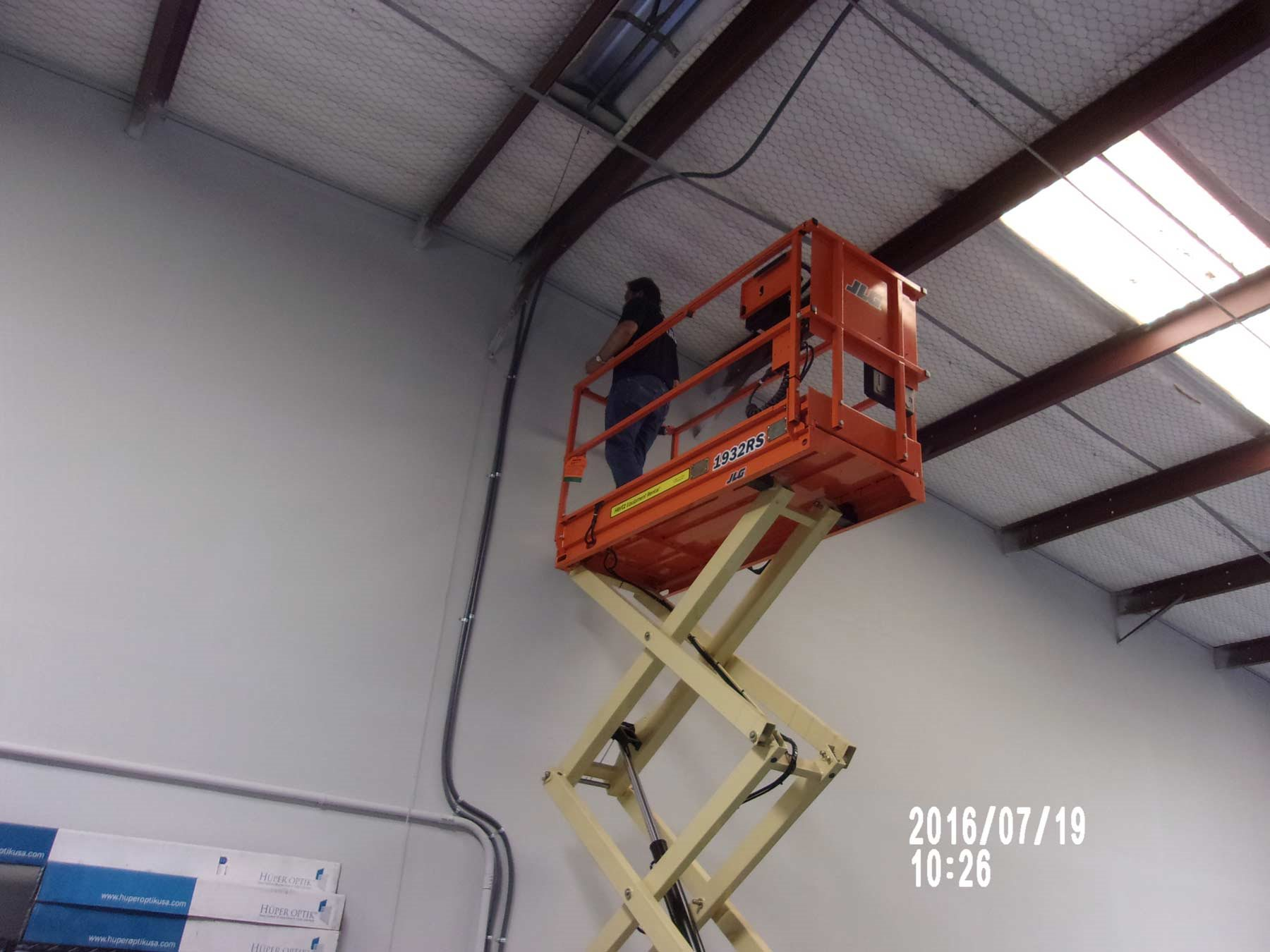employee on scissor lift