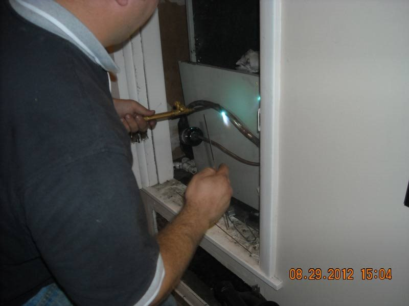 employee working on heater unit