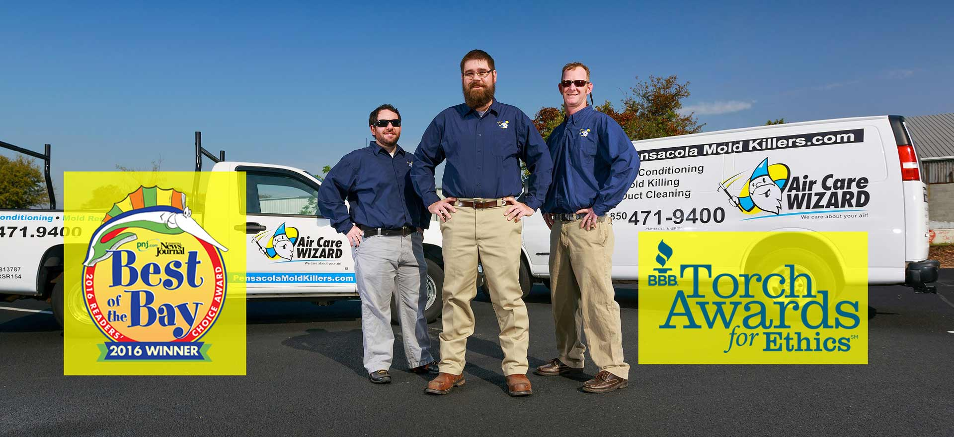 Air Care Wizard technicians standing in front of work vehicles