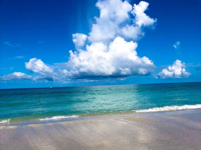 Beach Front composition of clear water and blue skies