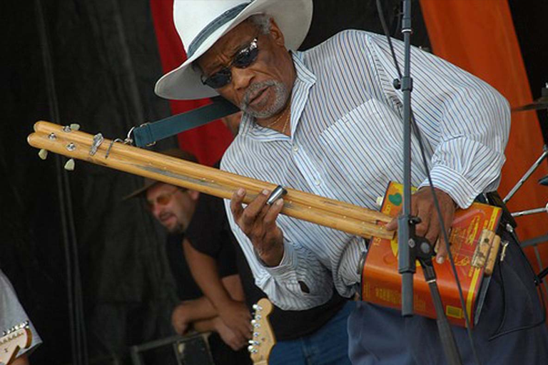 Mac Arnold playing guitar