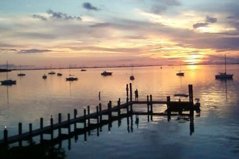 Sun setting at pier