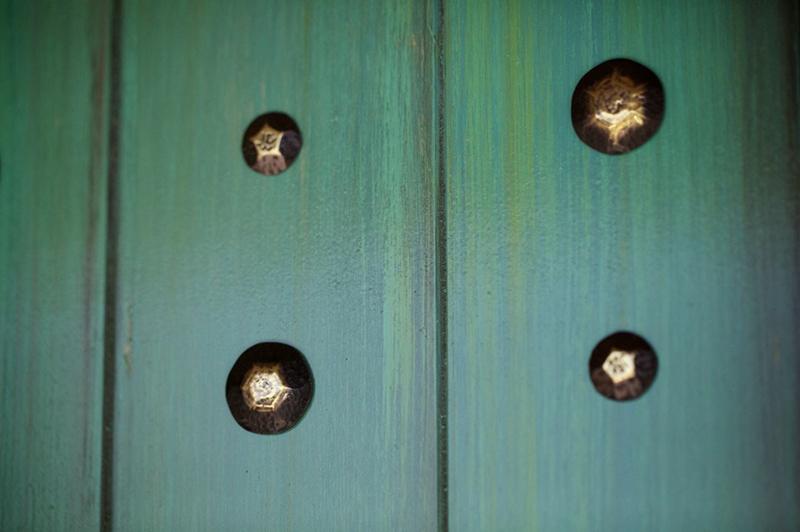 Door detail showing brass decoration