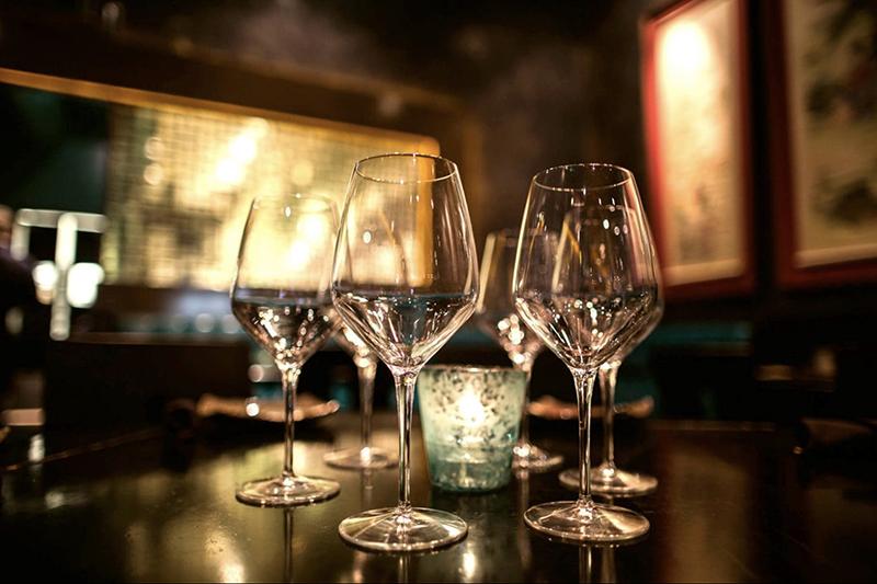 Four empty wine glasses on a table