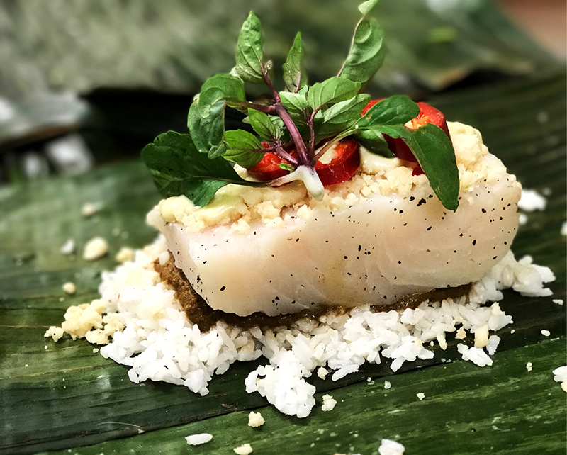 Wild Thai Halibut in Banana Leaf - thai herbs & spices, lemongrass rice, steamed in banana leaf, flour tortillas, macadamia nuts, creamy chili basil sauce