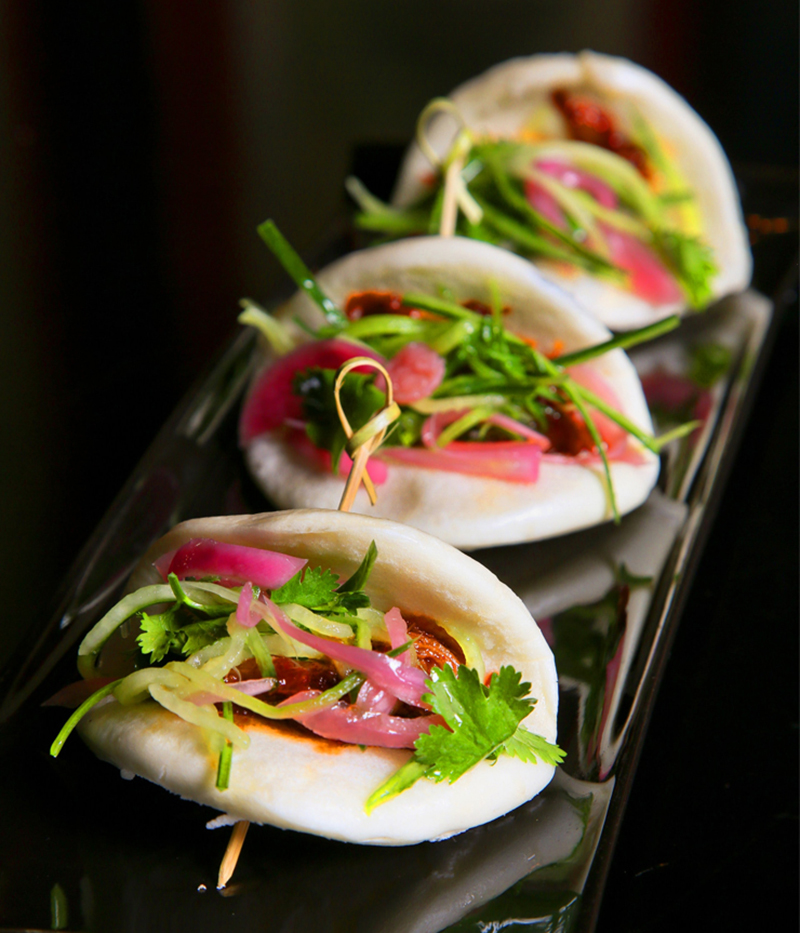 Braised BBQ  Pork Buns - soy, ginger, pulled pork, pickled red onion, cucumber, cilantro