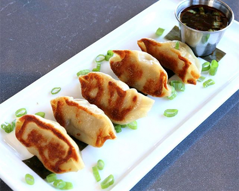 Silk Road Potstickers (pan fried) - shrimp & pork half moons, chili sesame soy sauce for dipping, steamed or pan fried
