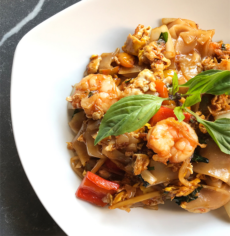 SoLag Drunken Noodle with Prawns - fresh pad see ew noodle, garlic soy, hint of heat, thai basil, bamboo shoot, green & red bell pepper, white onion, egg, cherry tomato, chili flake