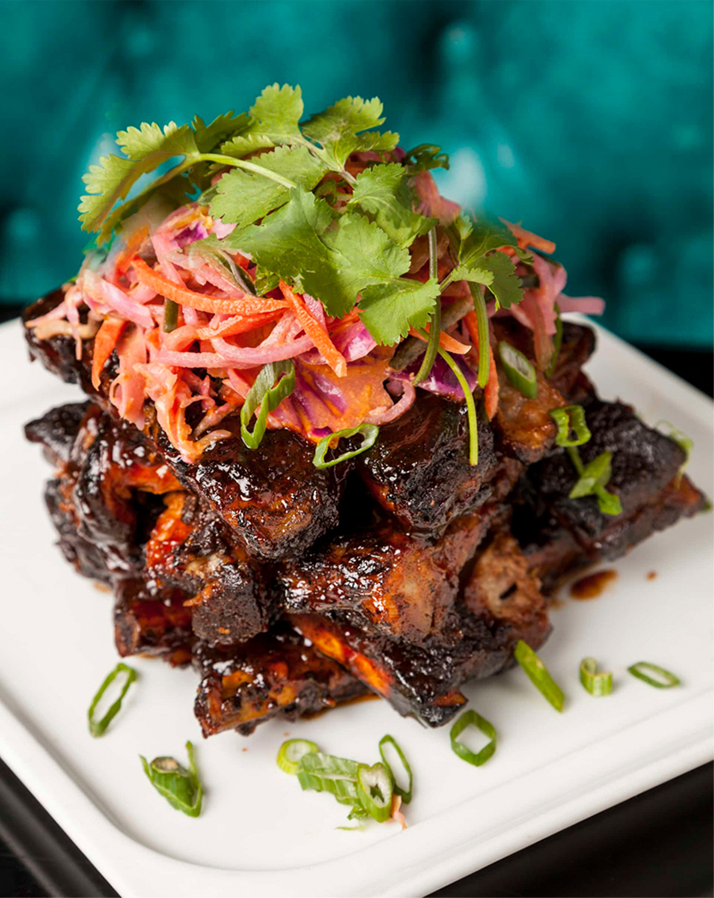Full rack Slow-Cooked Baby Back Wet Ribs with Spicy Asian Slaw - all natural Duroc Family Farms pork ribs, cooked in house 5 spice, rubbed in Katsu BBQ sauce, spicy asian slaw or rice