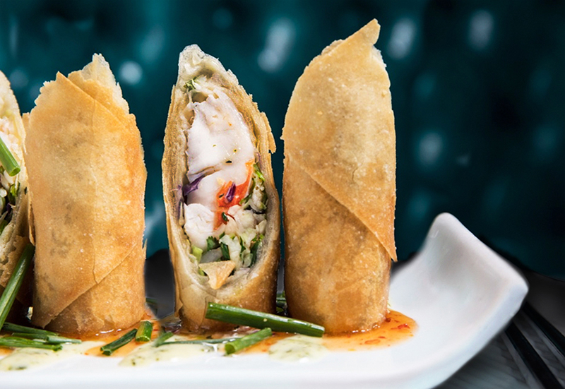 Crispy Lobster Spring Roll - lobster tail, red & green cabbage, fresno peppers, cilantro, basil, kaffir lime aioli, chili plum sauce